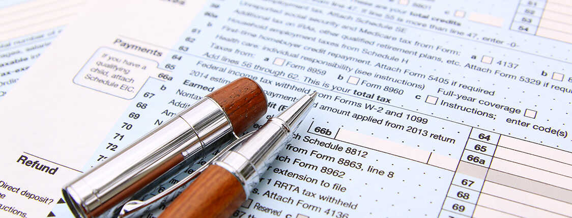 Tax return paperwork and a writing utensil