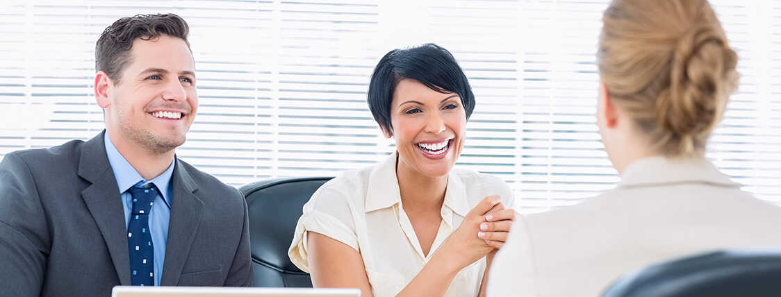 Pair of business professionals interviewing a candidate for a new financial services role