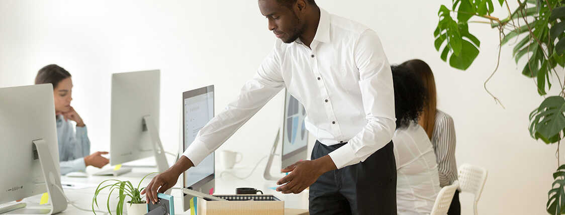 Man setting up his desk on the first day of hos new job