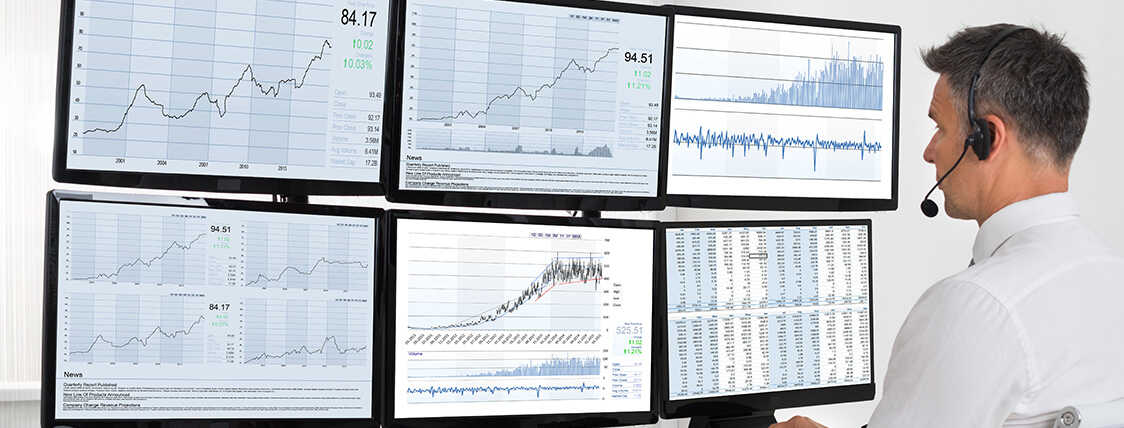 Series 7 license holder analyzing investment performance on 6 computer monitors