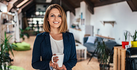 Woman holding coffee mug in interior design showroom image