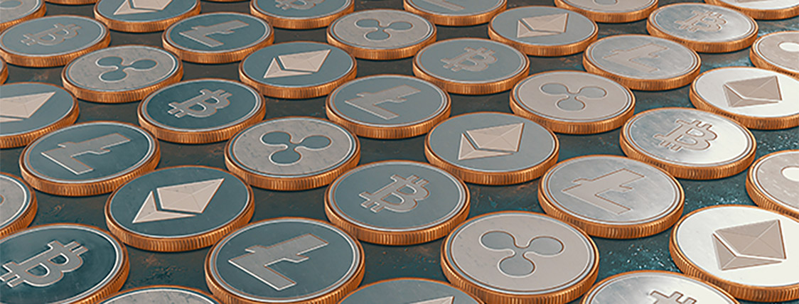 Coins representing cryptocurrency, one of the Fintech topics that will be tested on the CFA Exam