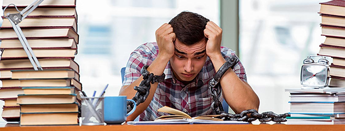 Man overwhelmed while studying the CFA Exam