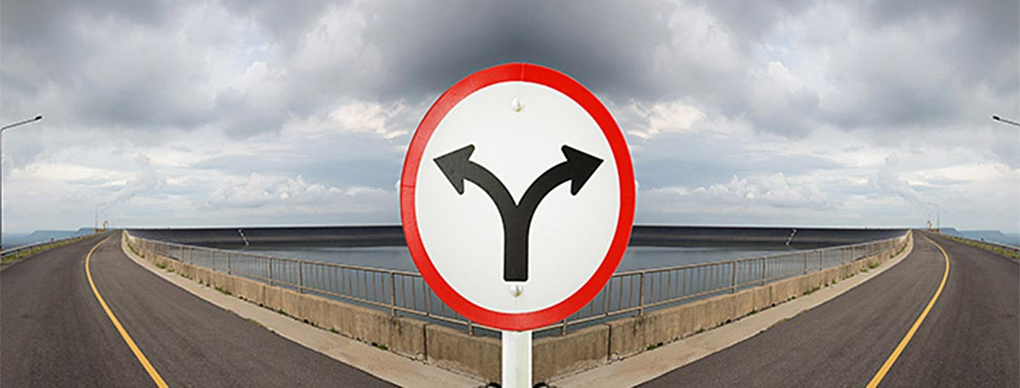 Fork in the road showing a decision - CFA charter versus CAIA charter