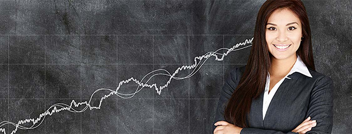 Female Portfolio manager standing in front of chalkboard