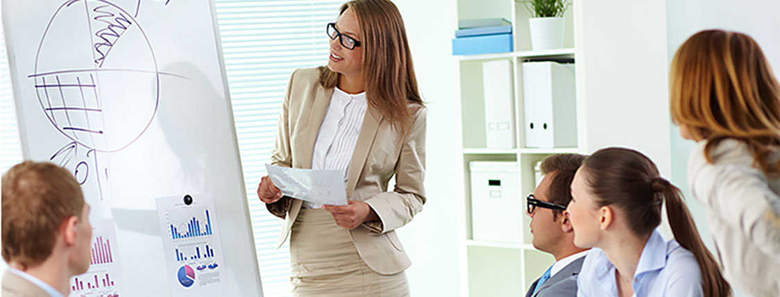 Female asset manager leading a meeting of colleagues