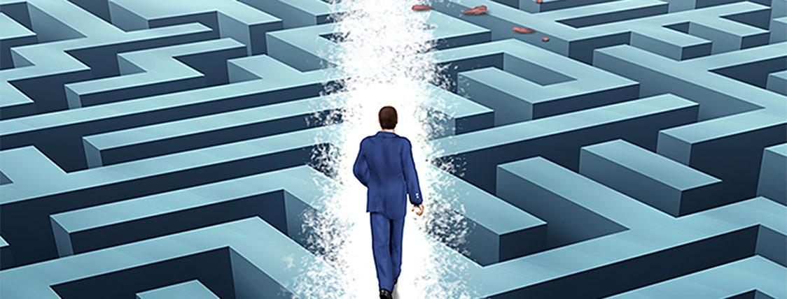 A Man progressing through a maze symbolizes designing a Strategy to Retake the CFA Exam