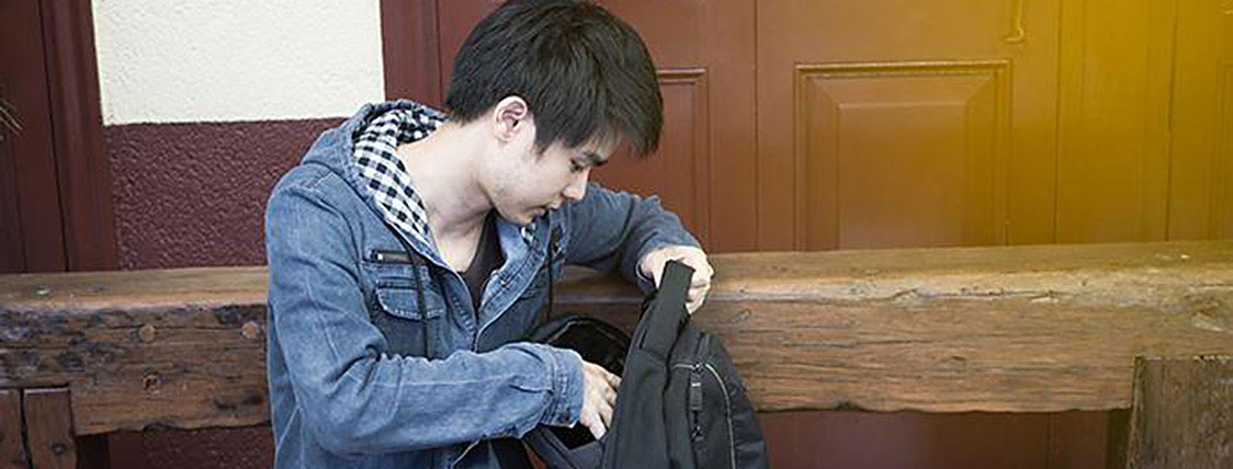 Student getting together everything he needs to take the CFA Exam